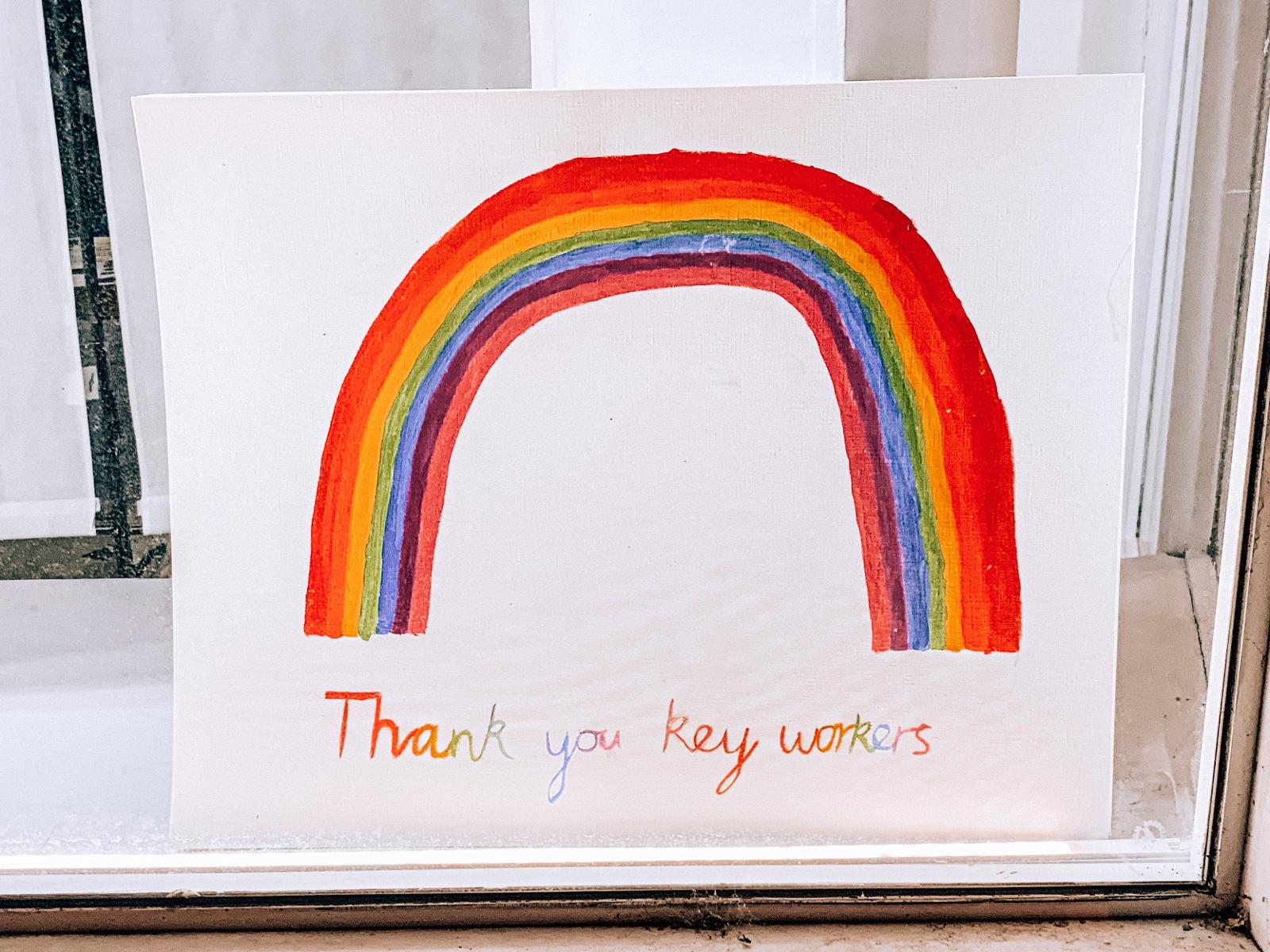 Child thank you drawing of rainbow.